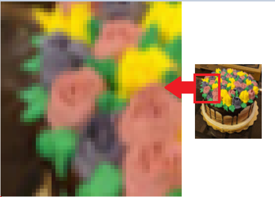 Shows how bitmaps pixelate when enlarged.ate